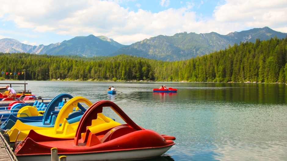 Paddleboats awaiting their passengers on the crystal clear water. Bavaria, 2015