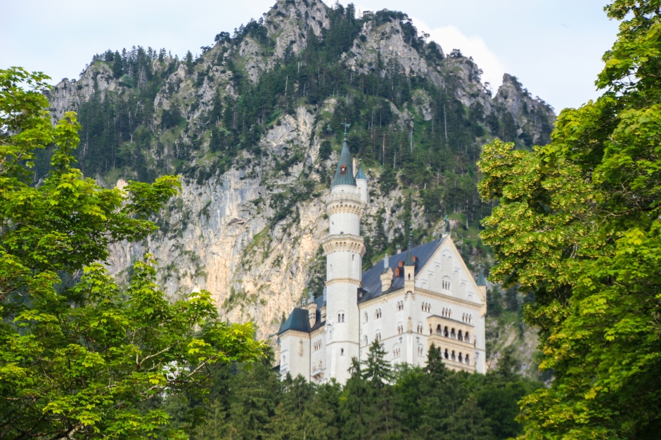 A glimpse of Neuschwanstein Castle from the town of Hohenschwangau below. Bavaria, 2015