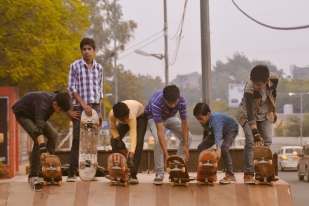"​The ""Sunday Morning Kids,"" more commonly known as slums kids, go out on a skateboarding field trip. They must head out to the streets as early as 6am so as to avoid street traffic or any trouble with the police. Free Motion Skatepark in Delhi provides the boards, shoes, elbow guards, and accompaniment on these early-morning trips taken on the first Sunday of each month, free of charge. New Delhi, India."