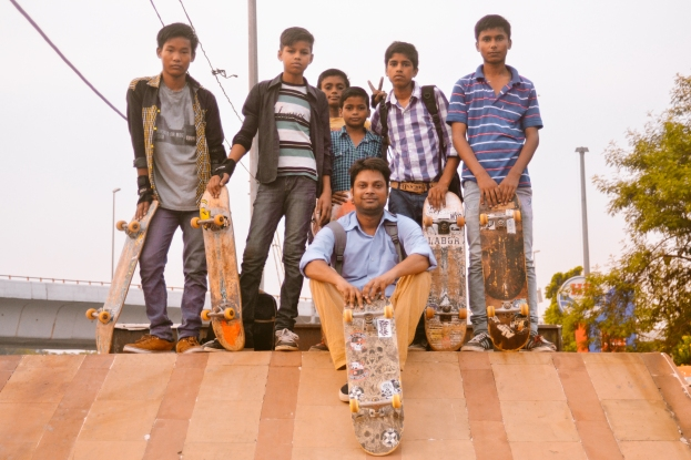 "​The Free Motion Skatepark ""Sunday Morning Crew"" poses for a photograph at the top of their DIY wooden ramp in New Delhi, India."