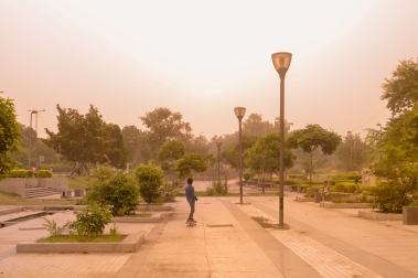 ​A young skateboarder enjoys the tranquility of early mornings in New Delhi, India.
