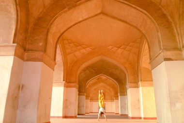 ​The only trick I know: a handstand at the Tomb of Akbar the Great in Agra, India.
