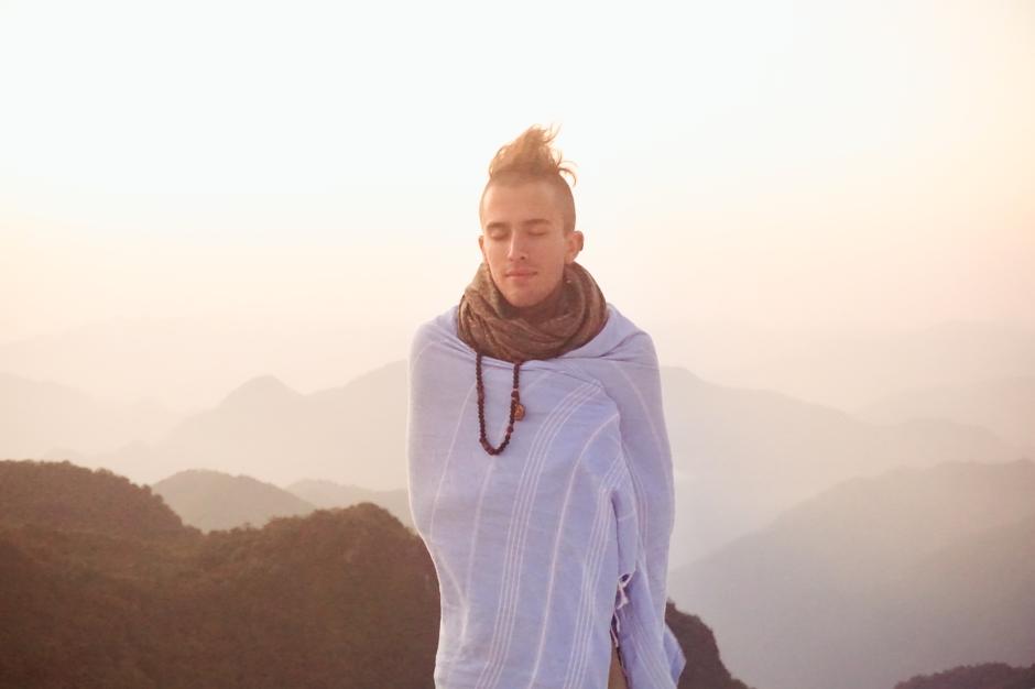 A fellow student enjoying the sunrise at the Kaunja Puri Temple in the Himalayan Foothills. Rishikesh, India.