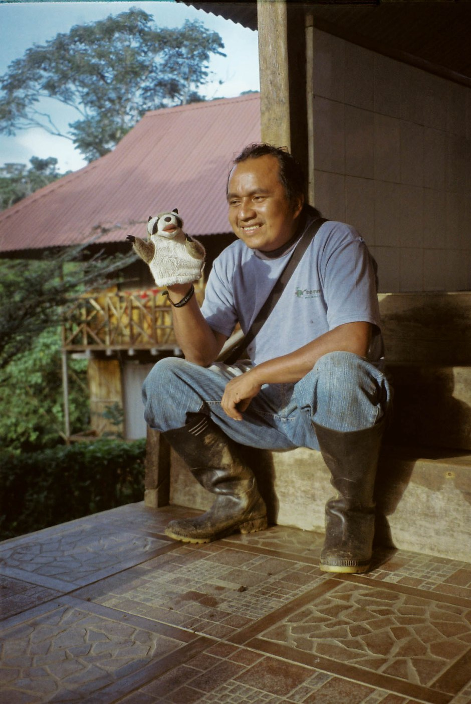 Our Quichua guide Teo holds my mapache puppet during a break between teaching us how to identify every Amazon insect and animal, build transects and quadrants, swing on vines, and eat bugs. Sinchi Sacha, Ecuador.