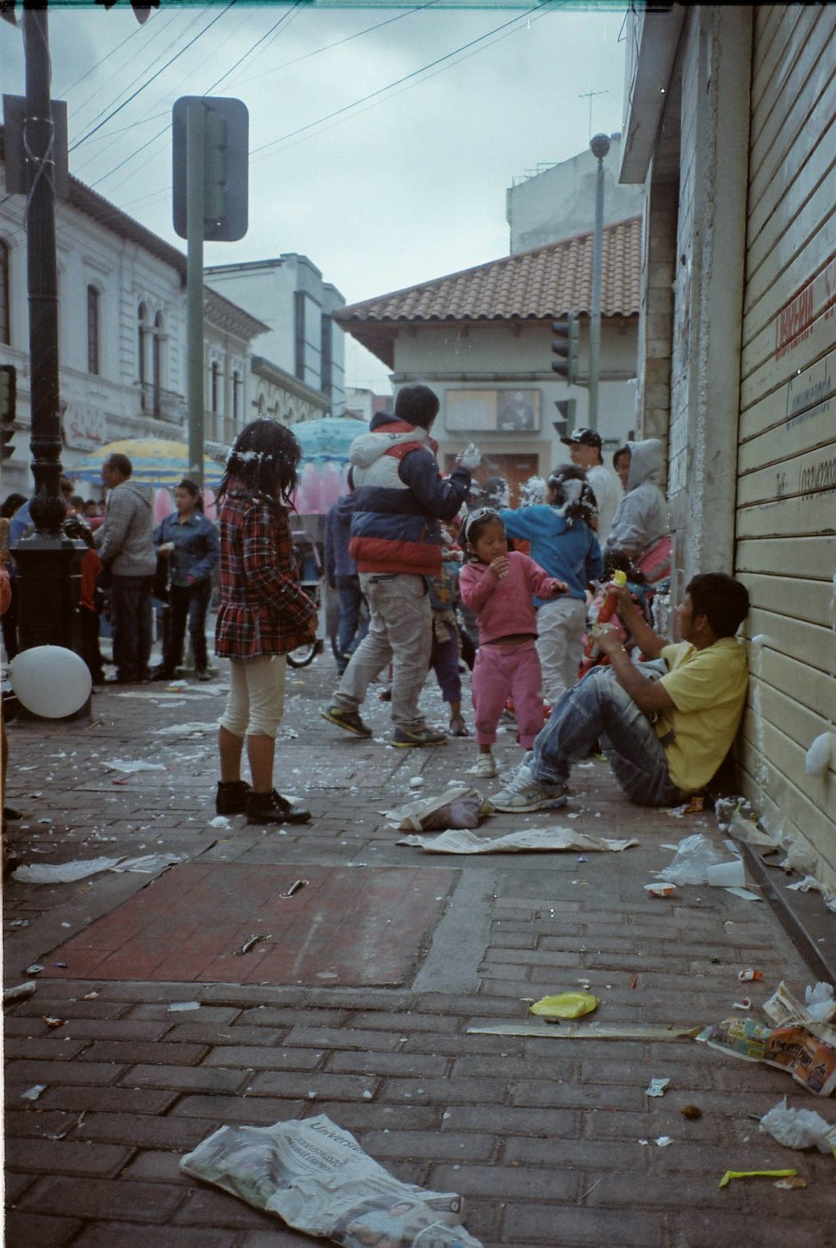 A few of the 20,000 people that travel to celebrate carnaval in the city of Ambato spray each other with espuma. It is impossible to walk outside without being attacked by this foamy shaving cream substance and it is unadvisable to travel these areas if not ready to partake in days of parades, outdoor concerts, and the endless running/chasing of these espuma wars. Ambato, Ecuador.