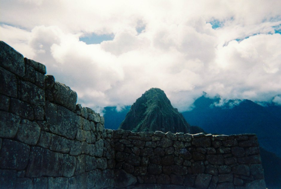 A view from outside the gate entrance of an ancient Incan temple. Machu Picchu, Peru.
